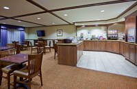Shoreview hotel's breakfast room with tables