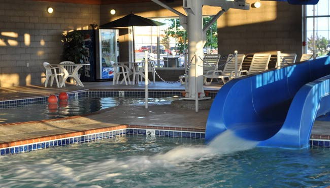 Hotel S Waterslide And White Lounge Chairs