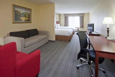 Hotel room with two beds, a TV and living area