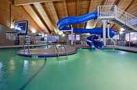 Hotel's indoor pool with waterslide and basketball goal