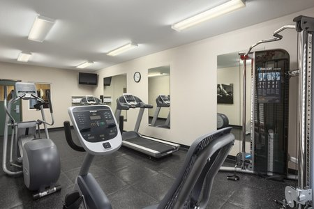 Fitness center with treadmill and cardio equipment