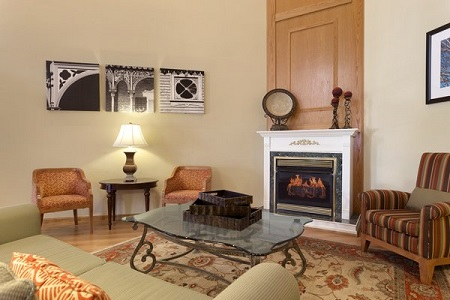 Hotel lobby with inviting fireplace and chairs
