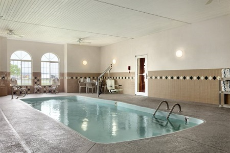 Indoor pool and two arched windows