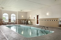 Indoor pool with two arched windows