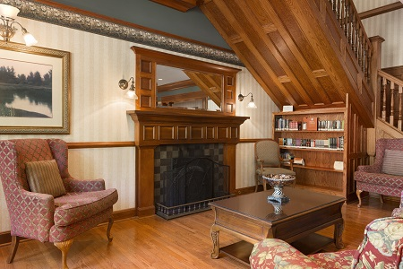 Hotel lobby with fireplace and library