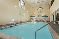 Indoor pool with tables, high ceilings and columns