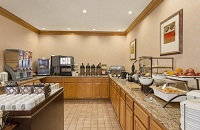 Breakfast servery with hot entrées and assorted cereals, juices and brews of coffee