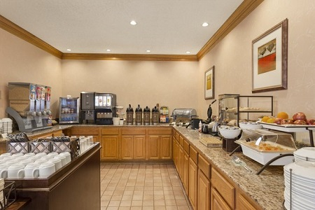 Breakfast servery with classic dinnerware, hot meal options and assorted cereals
