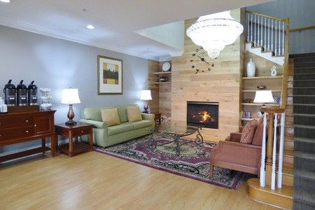 Lobby featuring a comfortable sitting area with a fireplace and a coffee station