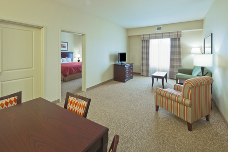Hotel suite with dining and living areas