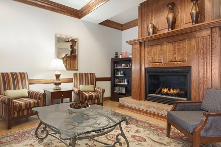 Comfortable lobby with armchairs and a roaring fireplace