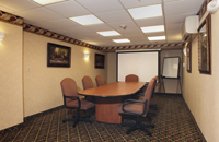 Meeting room with long table and chairs