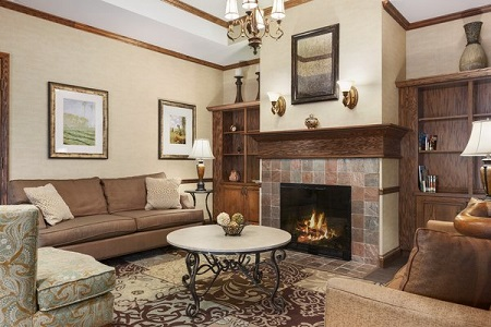 Spacious lobby with a fireplace and plush seating
