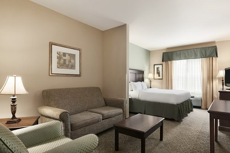 Asheville suite with a sleeper sofa, an armchair and a bed