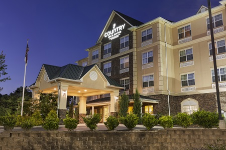 Exterior of the Country Inn & Suites, Asheville West lit up at night