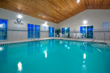 Indoor pool with wood ceiling