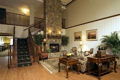 Hotel lobby with a stone fireplace and plush sofa