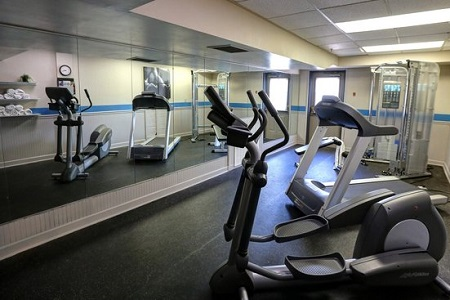 Modern hotel fitness center with a treadmill and an elliptical