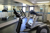 Modern fitness center with a treadmill at our Charlotte hotel