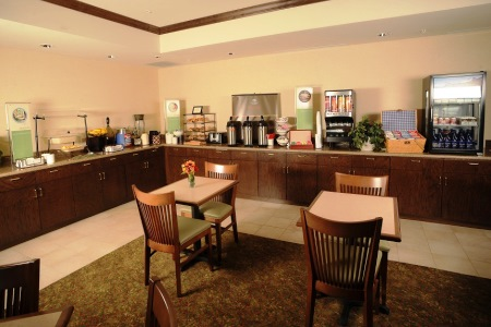 Dining area with coffee and oatmeal on the breakfast bar
