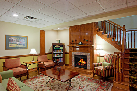 Hotel lobby with a fireplace and library