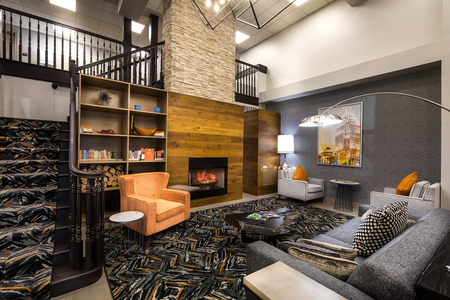 Lobby with modern fireplace, bookshelves and comfortable seating