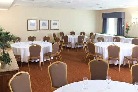 Hotel meeting space set up with round tables