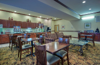 Calming hotel dining room with a free, hot breakfast