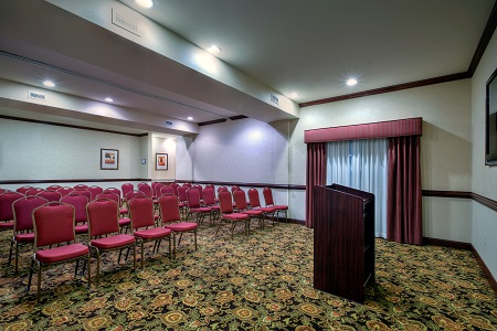 Hotel meeting room with a podium and theater-style seating