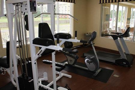 Modern fitness center with a treadmill at our Wilson hotel
