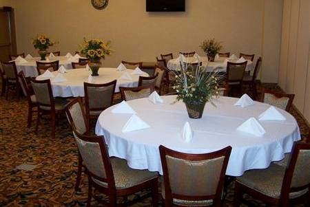 Beautiful reception with round tables in our Wilson hotel's meeting room