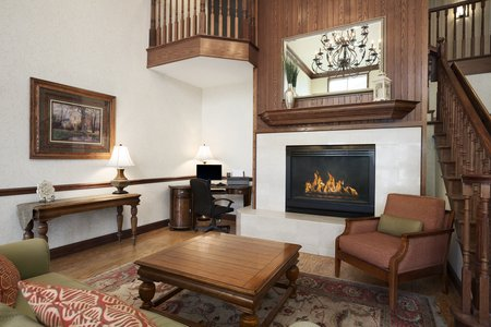 Comfortable lobby with seating area and a roaring fireplace