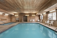 Heated indoor pool with deck chairs