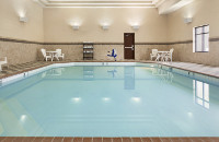 Lincoln, NE hotel's indoor pool area with high ceilings