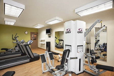 Fitness center with cardio and strength machines