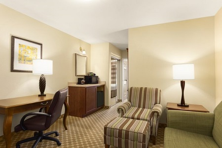 Hotel suite in Hobbs with a sofa and a desk