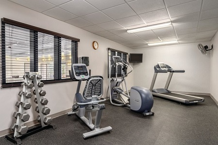 On-site fitness center with free weights, a stationary bike, an elliptical and a treadmill