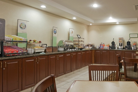L-shaped counter with breakfast spread at Cortland hotel