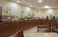 Dining area with breakfast counter and table seating