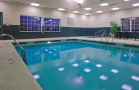 Rectangular indoor pool with bright blue water
