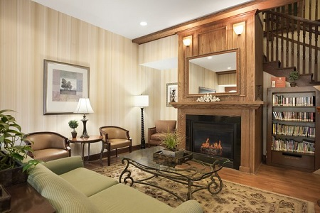 Spacious lobby with fireplace and seating