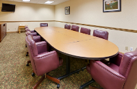 Conference table and red chairs in our Mount Morris meeting room