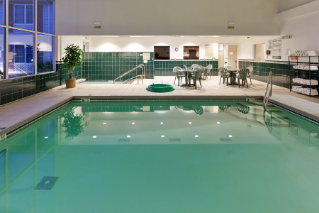 Indoor pool area with natural lighting in Mount Morris