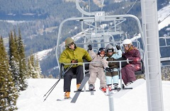 A group of four riding a ski lift