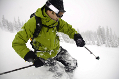 Man skiing down a snowy slope