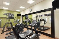 Fitness center with a treadmill, an elliptical and a weight machine