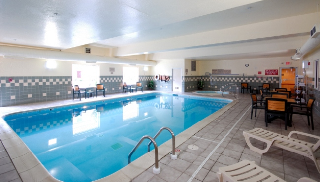 Indoor Pool Area With Gray And White Tile Walls