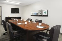 Columbus boardroom with white mugs and a flat-screen TV