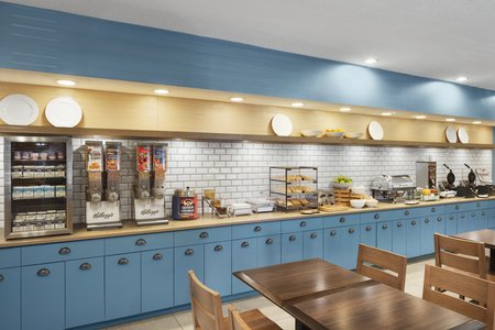 Light blue cabinets in the dining room at our CMH airport hotel