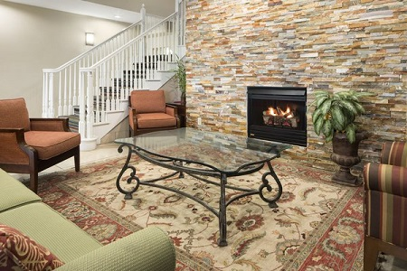 Comfortable lobby with seating around the fireplace
